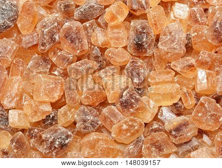 Brown gourmet caramelized sugar cube background. Food texture.