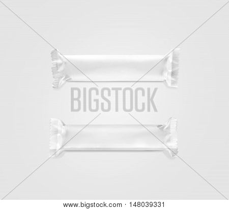 Blank white candy bar plastic wrap mockup top and back side isolated clipping path 3d rendering. Closed chocolate bar packaging wrapper template. Choco factory logo candybar package mock up. Sweet pastry shop.