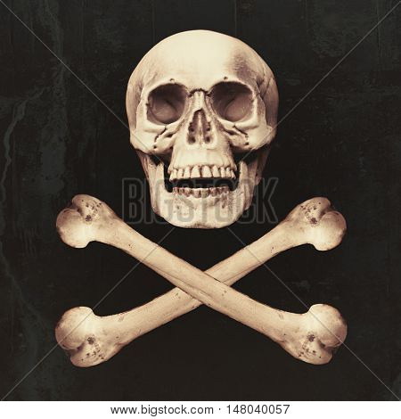 Skull and crossbones on textured background for Halloween