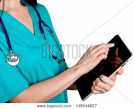 Medical professional in scrubs holding a tablet computer