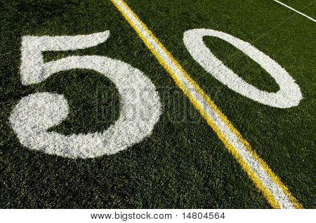 Photo of a American Football field 50 yard line.