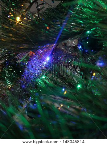 Twinkling Christmas light and sparkles on a blurred background create a festive mood