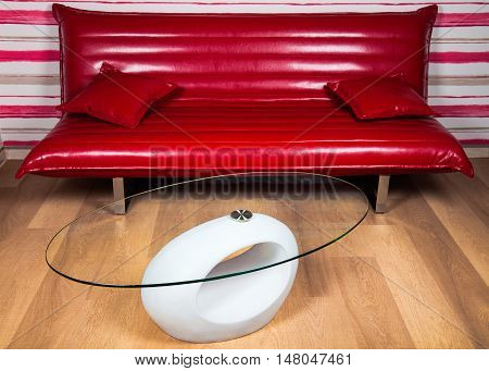 Contemporary vinyl or leather sofa and a coffee table