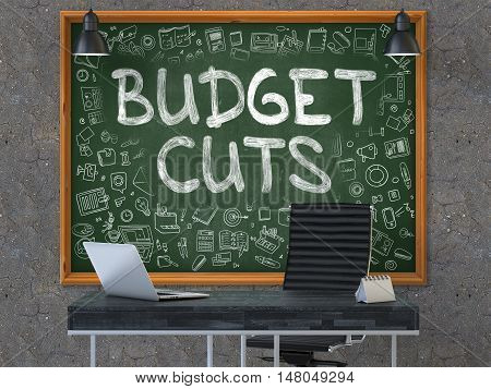 Hand Drawn Budget Cuts on Green Chalkboard. Modern Office Interior. Dark Old Concrete Wall Background. Business Concept with Doodle Style Elements. 3D.