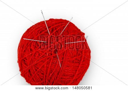 Ball of yarn with needles in it