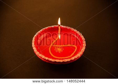 Clay diya lamp lit during diwali celebration. Greetings Card Design Indian Hindu Light Festival called Diwali