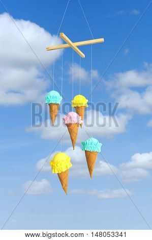 Garland in the form of ice cream. Colored ice cream fabric on sky with white clouds background