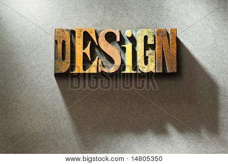 Das Wort Design in zufälligen hölzerne Buchdruck Zeichen auf grauen Papierhintergrund.