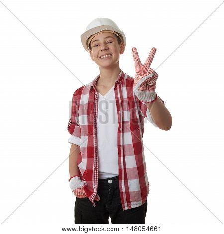 Cute teenager boy in red checkered shirt and building helmet showing victory sign over white isolated background, half body, constructing concept