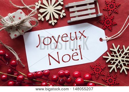 Christmas Decoration Like Gift Or Present, Sleigh. Card For Seasons Greetings With Red Paper Background. French Text Joyeux Noel Means Merry Christmas