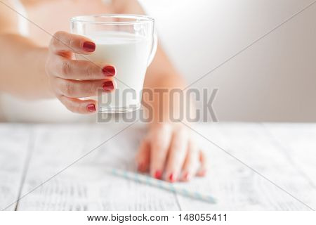 Woman In Bra Holding Cup Of Milk On Her Bedroom