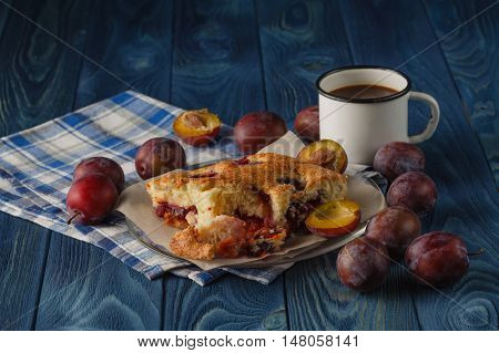 Delicious plum cake with organic plum on blue background