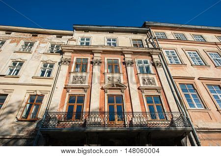 old historic building with windows on the street.