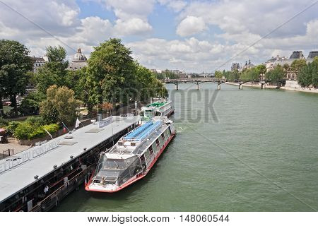 PARIS, FRANCE - AUGUST 06, 2016: tourist boat on the river seine near pont Neuf