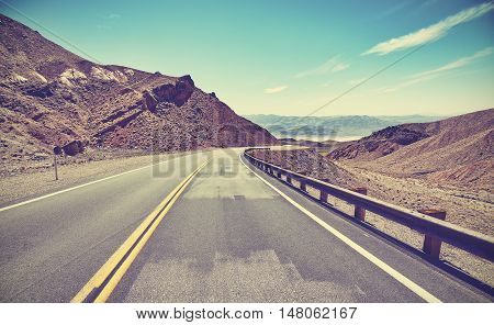 Vintage Toned Desert Road, Travel Concept.