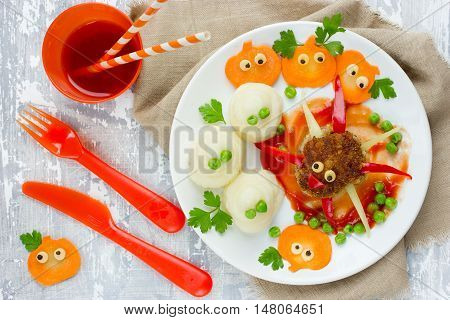 Halloween dinner or lunch for kids - spider meatball mashed potatoes ghost and mini funny pumpkin top view