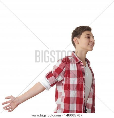 Cute teenager boy in red checkered shirt with arms raised outstretched smiling joyful over white isolated background, half body, freedom concept