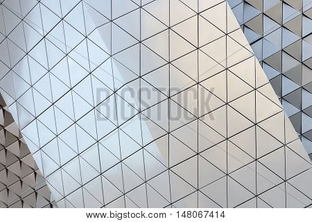 Abstract photo of modern aluminum ventilated facade of triangles