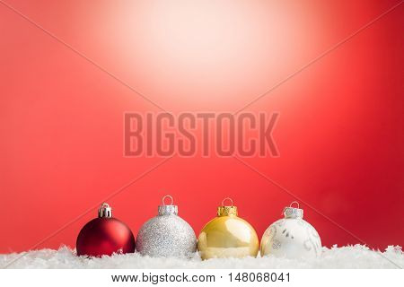 Composite image of Christmas bauble against red background