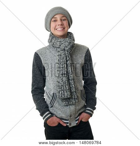 Cute teenager boy in gray sweater, hat and scarf over white isolated background, half body