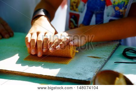 making candle from honey bee wax plate at market