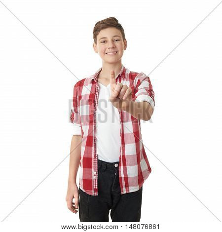 Cute teenager boy in red checkered shirt pushing something in front himself over white isolated background, half body