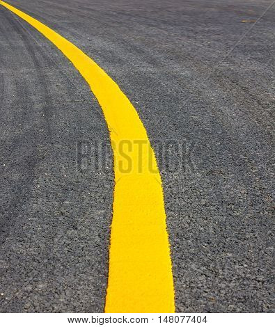 road Asphalt surface of the road with a yellow line.