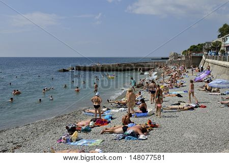 People Are On Beach Of Miskhor Coast In Crimea, Russia.