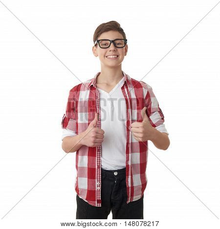 Cute teenager boy in red checkered shirt and glasses showing thumb up sign over white isolated background, half body