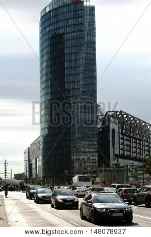 BERLIN, GERMANY - JUNE 21: Road transport and traffic at the modern Bahn Tower from the German Railroad at Potsdam Square on June 21, 2016 in Berlin.