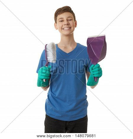 Cute teenager boy in blue T-shirt and green rubber gloves scoop and brush over white isolated background, half body, cleaning concept
