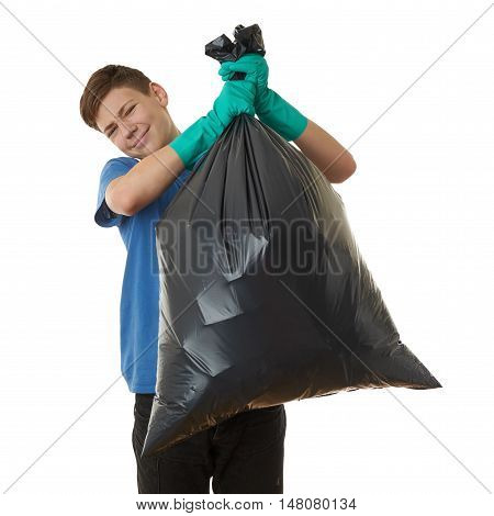 Cute teenager boy in blue T-shirt and green rubber gloves with garbage bag over white isolated background, half body, cleaning concept