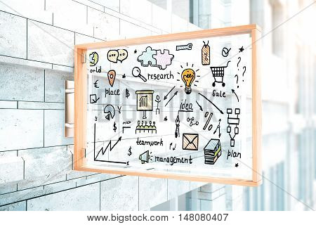 Closeup of transparent glass stopper with creative business sketch hanging outside on concrete building. 3D Rendering