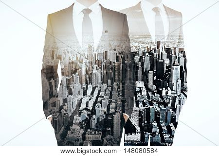 Businesspeople On City Background Multiexposure