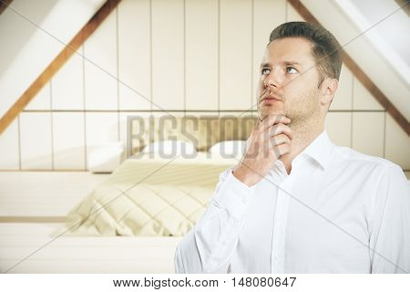 Portrait of thoughtful european businessman in bedroom interior