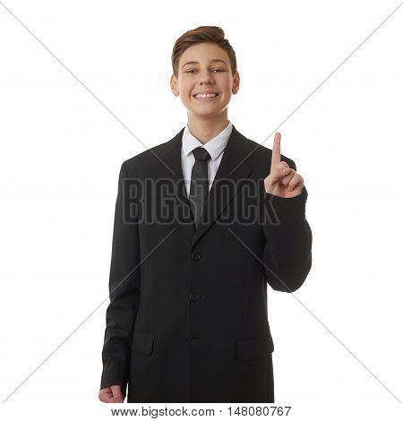 Cute teenager boy in back business suit pointing up over white isolated background, half body, future career concept