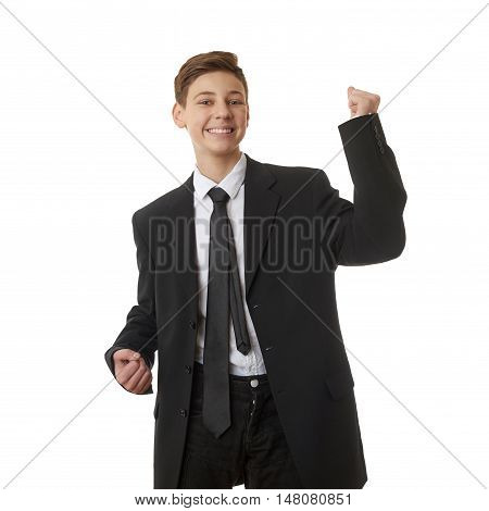 Cute teenager boy in back business suit with success gesture  over white isolated background, half body, future career concept