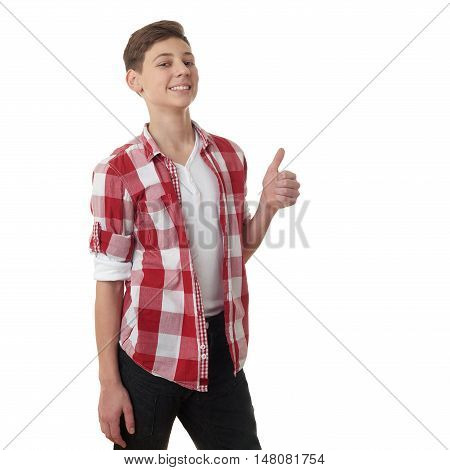 Cute teenager boy in red checkered shirt showing thumb up sign over white isolated background, half body