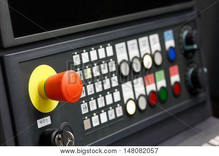 Control panel of CNC machining center. Closeup view. Selective focus.