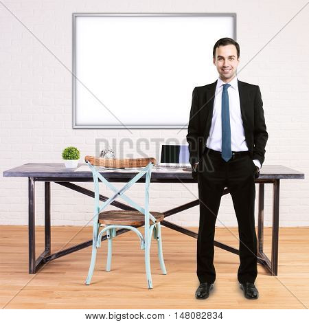 Businessman in moder office with desk chair and blank whiteboard on brick wall background. Mock up
