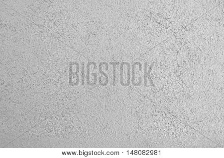 Gray stucco cement wall Background texture empty.