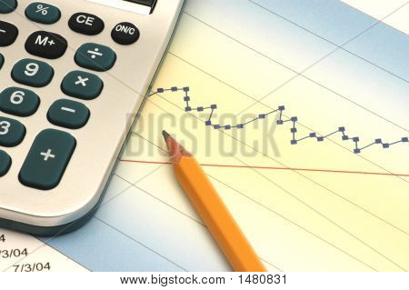 Close-Up Of Stock Report With Calculator And Pencil