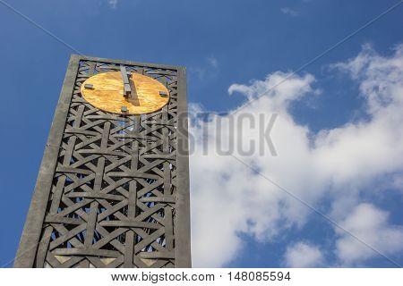 Modern metal clock on the Forum square in Bielefeld Germany