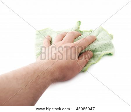 Green rag in hand over white isolated background