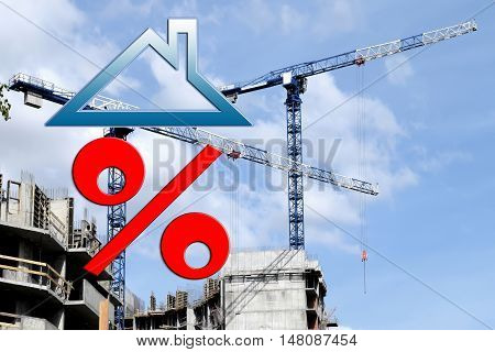 Red percent sign on the background of building a house. The concept of price changes on the real estate market