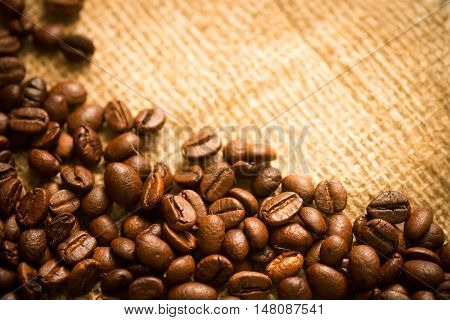coffee beans on sackcloth with copy space