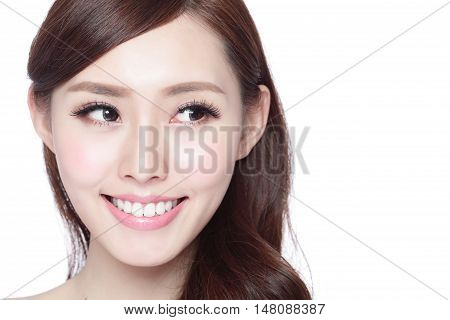 Beauty woman with charming smile and look to something empty copy space she has health skin teeth and hair isolated on white background asian beauty