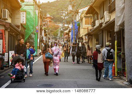 KYOTO JAPAN - NOVEMBER 13 2015: Unidentified Japanese girl with traditional dress walk to Kiyomizu temple. Kiyomizu-dera is the most famous landmark in Kyoto.