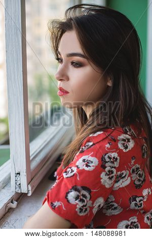 alone thoughtful sadness girl is sad at the window