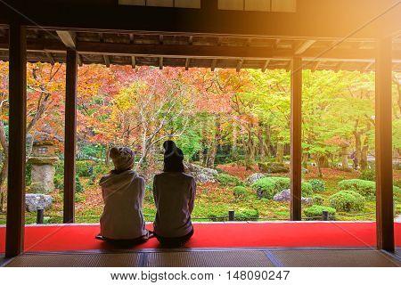 Japanese Girls In Enkoji Temple Enjoy Autumn Colorful Garden